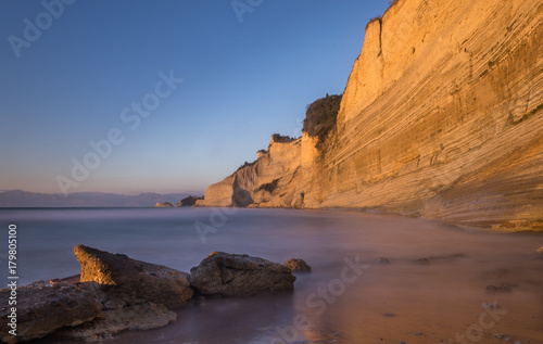 Fotobehang Diepbruine Sunset long exposure shot of Loggas beach in Corfu Greece.