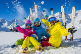 Happy family enjoying winter vacations in mountains. Playing with snow, Sun in high mountains. Winter holidays. - 179806161