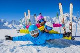 Happy family enjoying winter vacations in mountains. Playing with snow, Sun in high mountains. Winter holidays. - 179806945