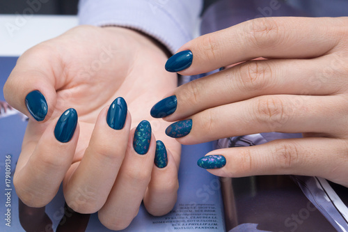 Deurstickers Manicure Beautiful natural nails and attractive manicure on women hands.
