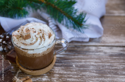 Foto op Canvas Chocolade Cup of hot chocolate cocoa with whipped cream and chocolate crumbs on wooden table with christmas decoration. Delicious cold weather beverage concept.Copy space