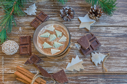 Foto op Canvas Chocolade Delicious cup of hot chocolate cocoa with Christmas tree candies on wooden table with chocolate slices and christmas decoration. Winter holidays drink concept. Top view.