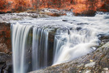 Autumn waterfall in deep forest