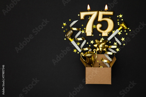 Number 75 gold celebration candle and gift box background Poster
