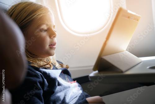 Little girl watching movie during flight