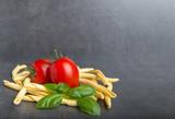 Raw Italian pasta on a stone table - 179821528