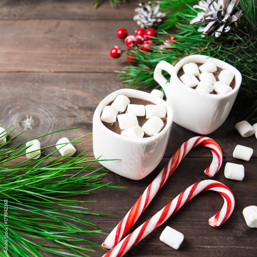 Foto op Canvas Chocolade Hot drink with marshmallow and lollipops and fir tree decorations