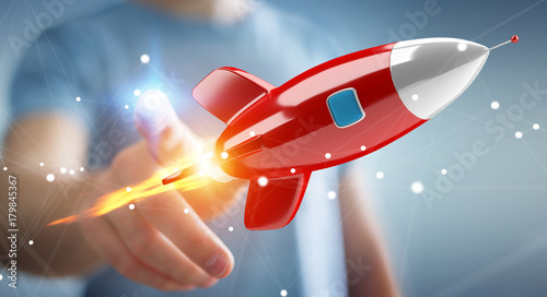 Businessman holding and touching a rocket 3D rendering - 179845367