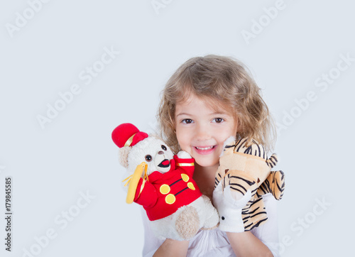 five year old girl with plush puppets Poster
