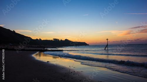 Fotobehang Zee zonsondergang The Seafront, Exmouth, Devon, UK