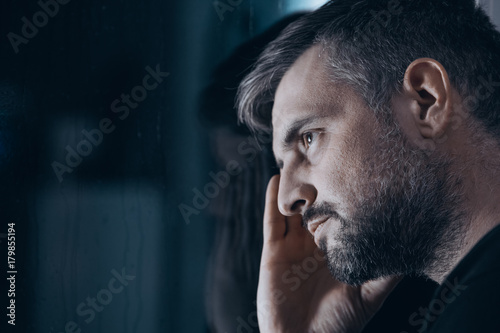 Thoughtful man with withdrawal symptoms