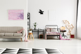 Spacious girl's bedroom with chair - 179855511