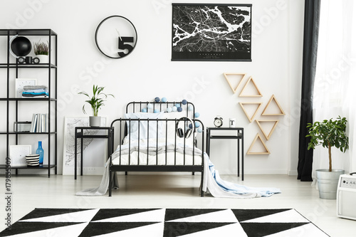 Monochromatic teenager's bedroom with mirror