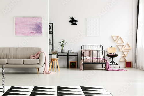 Spacious girl's bedroom with chair
