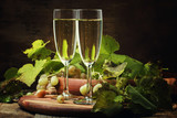Champagne In Glasses, Grapes With Vine, Vintage Wood Background, Selective Focus - 179860396
