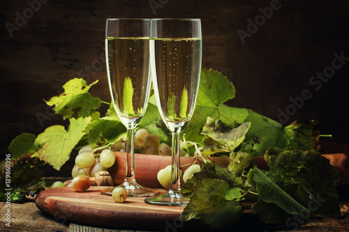 Plakat Champagne In Glasses, Grapes With Vine, Vintage Wood Background, Selective Focus