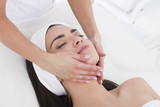 Beautiful woman in Spa having a facial massage.