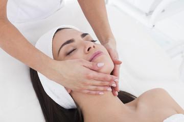 Beautiful woman in Spa having a facial massage.
