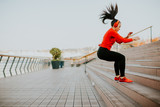Young woman exercising jumping outside