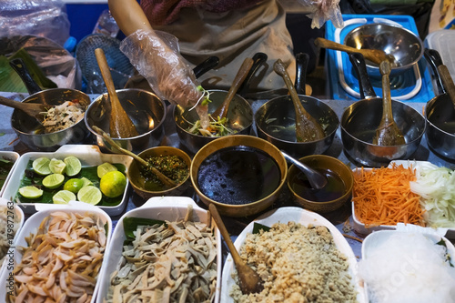 Food street cooking of traditional asian cuisine. Different ingridients on table