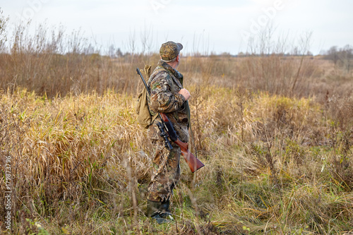 Fotobehang Jacht Hunter in camouflage with rifle. Winter hunting.
