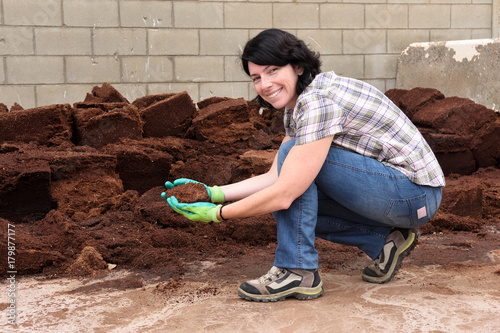woman working in the garden center, composting, Poster