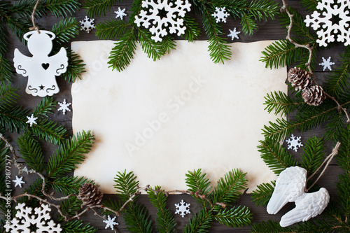 Christmas background for congratulations, spruce branches, paper, cones, snowflakes and decor - 179877577