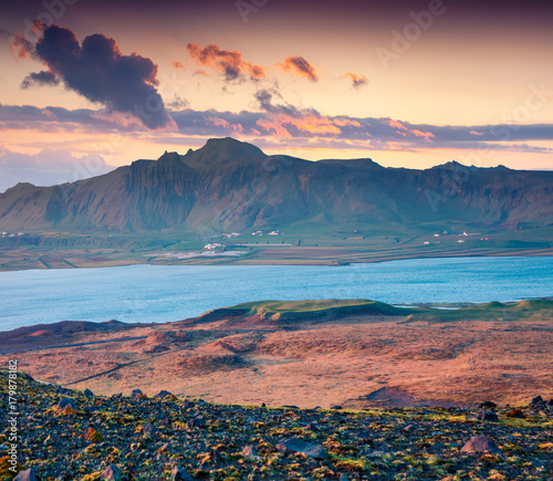 Foto op Canvas Zee zonsondergang Beautiful summer sunset on the south coast of Iceland, Kirkjufjara beach location