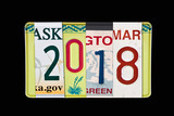 2018 writtten with US licence plates, black slate background - 179879307