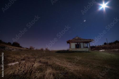 Foto op Plexiglas Chocoladebruin Chapel under the night sky