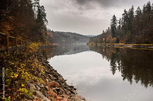 Foto op Plexiglas Chocoladebruin Autumn coast of Vltava river