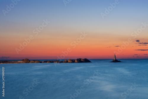 Fotobehang Zee zonsondergang Slow sunset by the sea