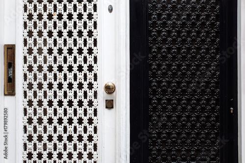 Keuken foto achterwand Vlinders in Grunge Old ornate iron door entrance forged black white holland