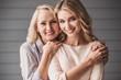 Leinwandbild Motiv Senior mum and adult daughter