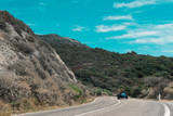 Classic sports car driving on mountain road in summer. Sardinia. Italy.