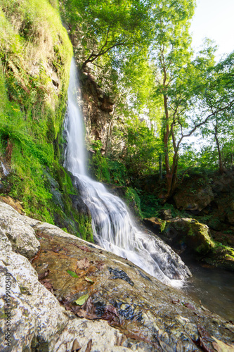 Landscape of one of water cascades of Oneta waterfalls in picturesque forest of Asturias, Spain.