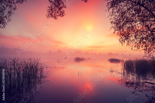 Plexiglas Crimson Early morning, dawn over the lake. Misty morning, rural landscape, wilderness, mystical feeling