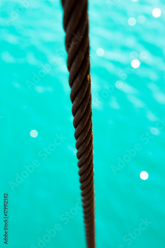 Papiers peints Vert corail Rope on a turquoise sea background
