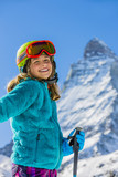 Girl on skiing on snow on a sunny day in the mountains. Ski in winter seasonon, the tops of snowy mountains in sunny day. South Tirol, Solda in Italy. - 179913177