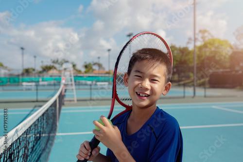 Aluminium Tennis Young tween Asian boy tennis player on outdoor blue court