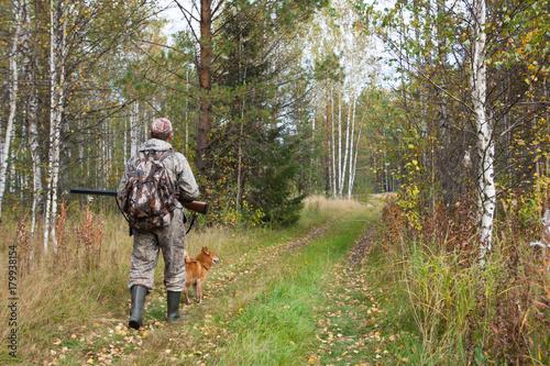 Fotobehang Jacht hunter with shotgun in the autumn forest