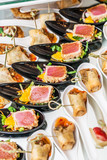 Gourmet appetizers: caviar, venison, tuna and salmon. - 179948346