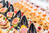 Gourmet appetizers: caviar, venison, tuna and salmon. - 179948347