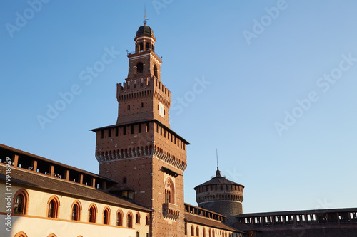 Foto op Canvas Milan Fragment of the castle wall with towers of Castello Sforzesco in the evening Milan, Italy