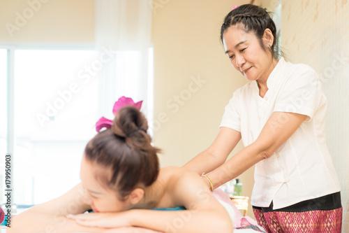 Fotobehang Spa Thai Massuer is pampering customer in Thai Spa, Focusing on the Therapist