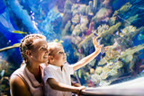 Mother and son watching sea life in oceanarium - 179954752