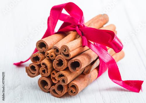 Fridge magnet cinnamon stick with red ribbon