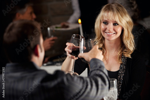 Restaurant: Couple Toasts On Romantic Date At Fancy Restaurant