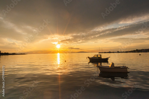 Foto op Canvas Zee zonsondergang Sunset on the coast