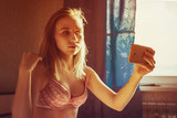 Half naked girl photographed themselves on the phone - 179981783